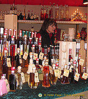 Cologne Weihnachtsmarkt stall selling colorful bottles of liqueur