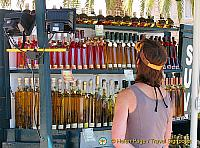 Colourful bottles of travarica - a herbal rakia or grappa
