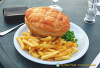 Steak and Kidney pie with potatoes and peas