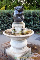 A hugging bear drinking fountain
