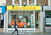 A cute orange car to advertise that Arancina is sold here
