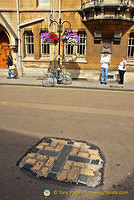 The Oxford Martyrs, Cranmer, Ridley and Latimer, were burnt at the stake here in 1555 and 1556. You can see this Martyrs' cross in Broad Street