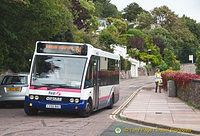 The local bus passes the Torquay Imperial