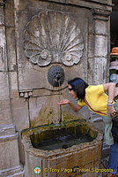 Drinking off a water fountain in Annecy