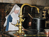 This nun is doing the cooking