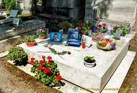 Grave of Gilbert Bécaud, known as Monsier 100,000 Volts