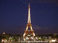 The Eiffel Tower sparkles by night