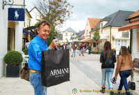Tony has his bag of Armani purchases