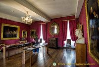 Red living room. On the right is a bust of Victor Hugo by David d'Angers and a portrait of VH and his son François-Victor