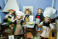 Dolls in kitchen costumes