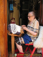 Look into doorways and you never know what you may see.  This lady was doing her crochet