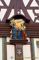 1581 wooden house with statues including Christ as a child