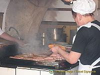 Bratwurst being cooked at Regensburg Wurstkuchl