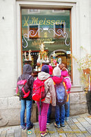 Some very young shoppers admiring the Meissen and Lladró porcelain