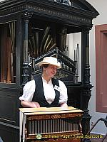 Museum guide demonstrating instrument