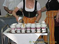 Asbach Uralt is poured into porcelain pots for Rudesheim coffee