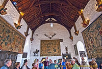 The walls of the Great Hall covered with tapestries