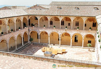 Courtyard of the Sacro Convento friary with 53 Romanesque arches