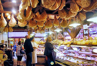 Legs of Parma ham decorate the ceiling of La Baita