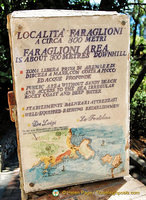 Sign indicating 300m to the Faraglioni Rocks