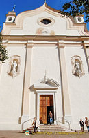 Statues of Saints Filippo and Giacomo adorn the plain facade of the parish church of Cortina d'Ampezzo