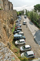 Cars parked outside Pienza historic city walls