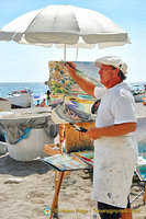 Artist at work on Positano beach
