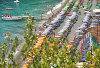 View of the colourful umbrellas on Positano beach
