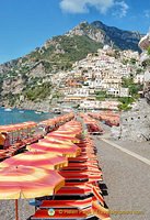Rows of bright umbrellas on the Spiaggia Grande or the big beach in Positano