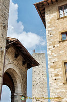View of Antony Gormley's man on the San Gimignano tower