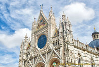 At the top of the west facade is the mosaic depicting the Coronation of the Virgin