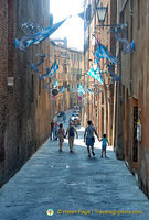 Streets of Siena decorated with flags of Onda who won the July 2012 Palio di Provenzano
