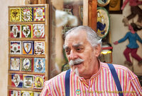 A distinguish-looking Siena shopkeeper