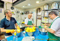 Men (including the boss) peeling lemons at the back of the Limonoro shop