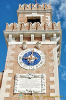 Arsenale tower with a blue-faced clock