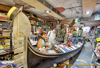 The gondola loaded with books reminds visitors that they are in Venice