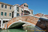 Like in Venice, many little bridges criss-cross the canal in Murano