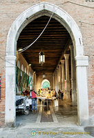 View of Mercato del Pesce through an entrance arch