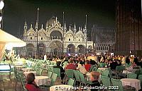 Crowds enjoying drinks and music in Piazza San Marco