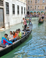 Enjoying a gondola ride during Acqua Alta