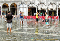 Tourists snapping each other in Venice's Acqua Alta
