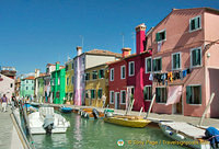According to legend, the bright colours of houses was started by Burano's fishermen who wanted to see their homes from a distance