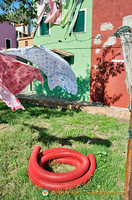 Everything's colourful in Burano, even the plastic pipe