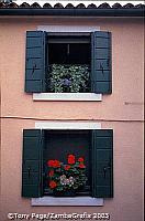 Decorative windows add to the quaintness of Burano