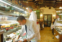 Waiters selecting seafood for orders