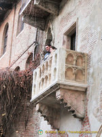 Young couple having their Romeo and Juliet moment on Juliet's Balcony