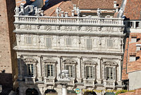 Palazzo Maffei with statues on the roof