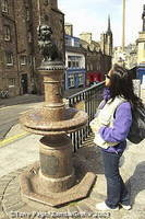 Greyfriars Bobby - a little Skye terrier sitting on an old drinking fountain near the gateway to Greyfriars Church [Greyfriars