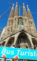 A tourist bus going past the Sagrada Familia