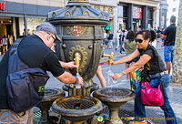Getting drinking water from the Font de Canaletes